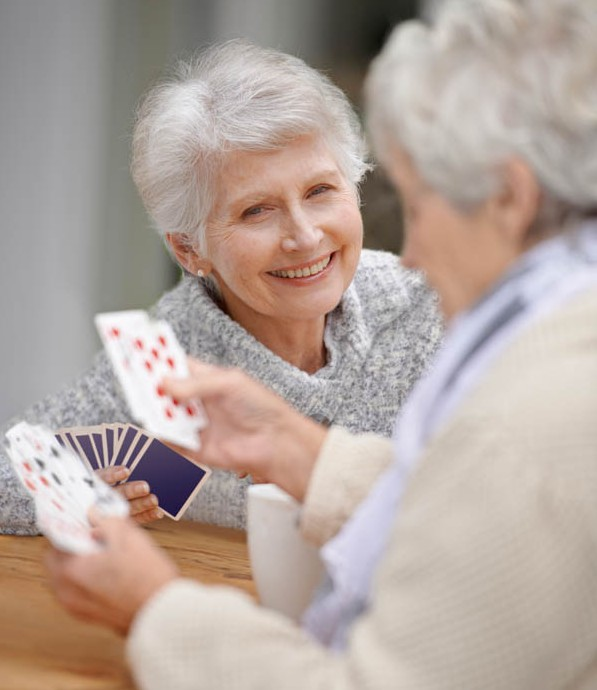Some senior citizens playing cards together