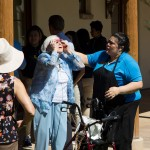A naya helps a resident safely look at the eclipse