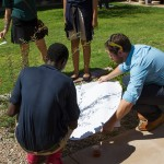 Cameron Taylor, Head of School at Imago Dei, looks at shadows with a scholar
