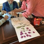 Juliet leading another project in Mesquite with Virginia, creating beautiful pressed leaf designs.