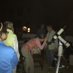 Residents lining up to get their turn at peeking through the telescopes into the starry November skies.